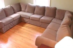 clutter free couch and hardwood floor